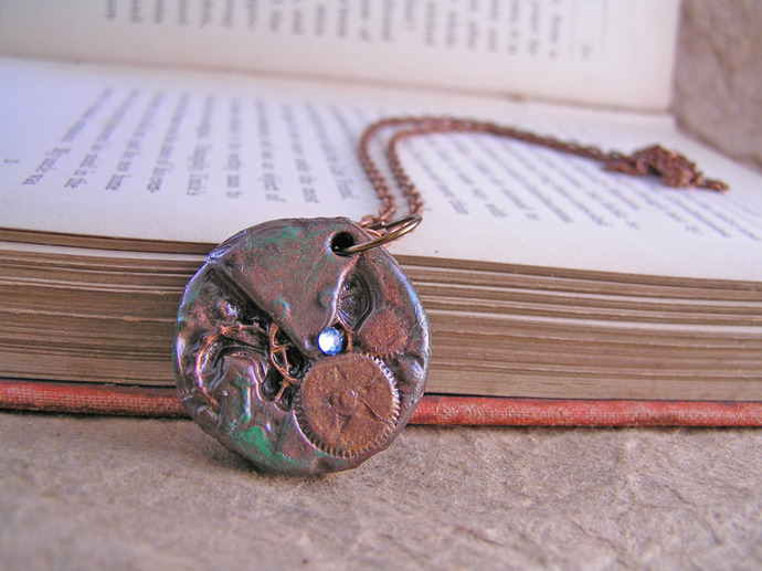 Steampunk clockwork pendant with blue swarovski gem
