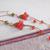 Orange Czech glass bellflower and fire polished bead earrings