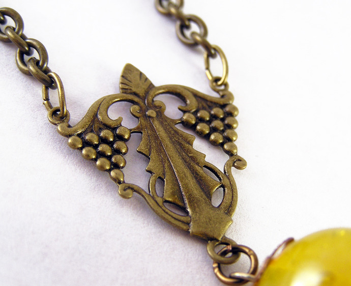 Steampunk Hot air Balloon necklace with aged copper floral filigree on bronze