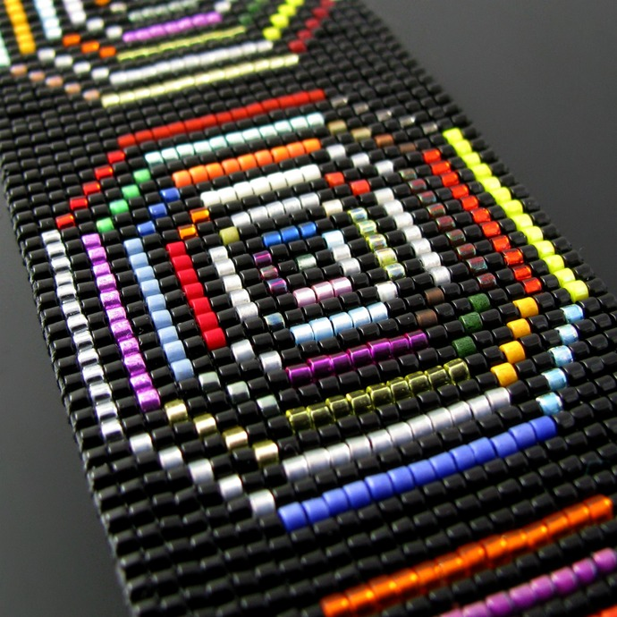 Hypnotizing bead loomed black and colorful bracelet