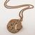 Custom personalized initials pendant in verdigris or burnished copper finish.