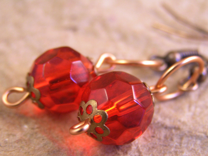 Red glass earrings with copper filigree beadcaps
