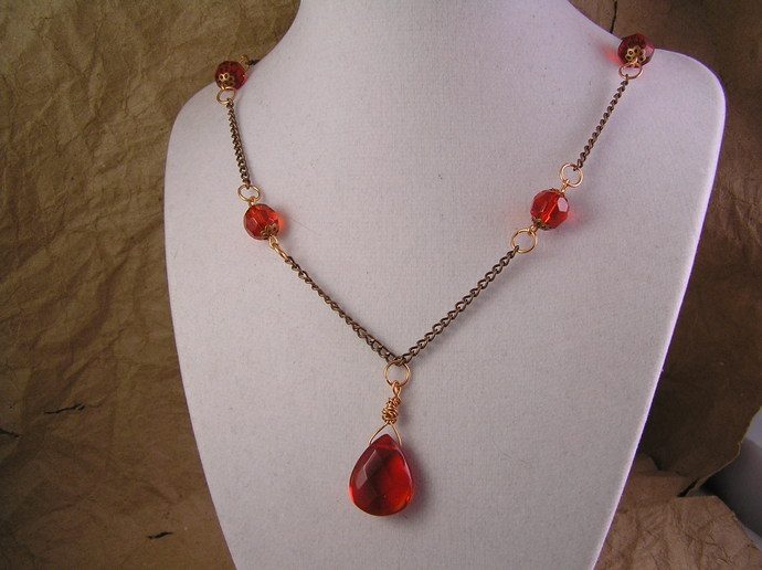 Red glass necklace with copper chain and filigree beadcaps