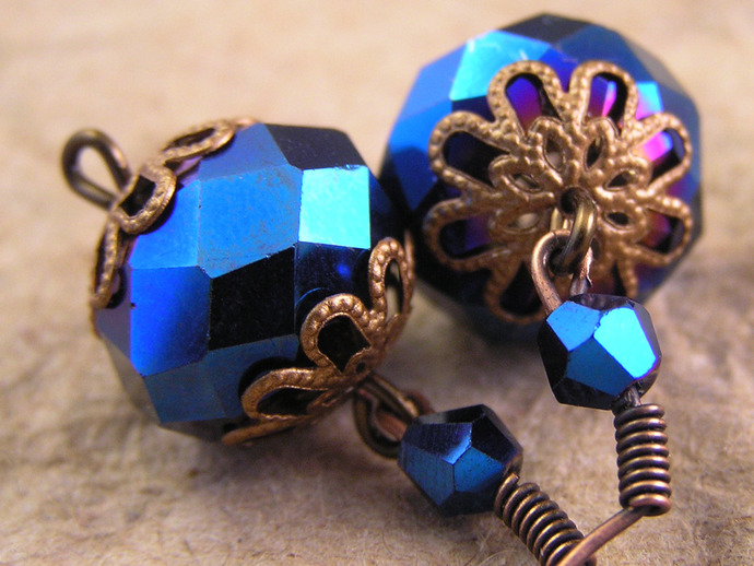 Blue faceted glass earrings with copper and metallic bead details