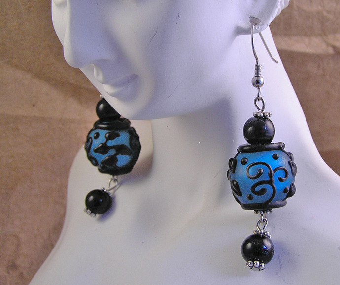 Blue and black swirl glass bead earrings