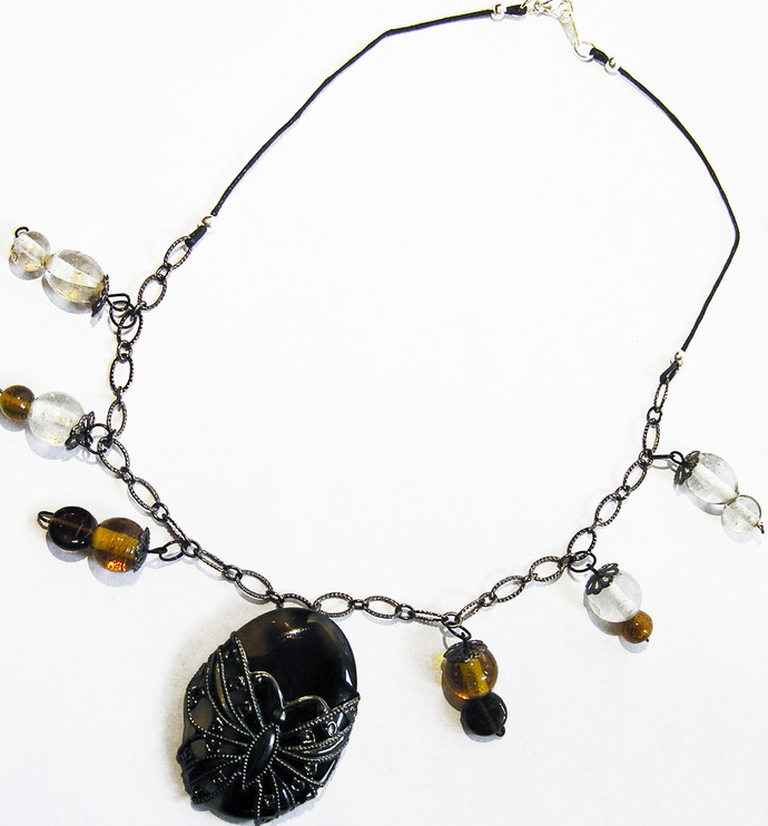 Butterfly filigree necklace with banded black agate and amber & yellow glass