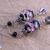 Lampwork glass flower bead earrings in black, rose, and silver