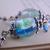 Lampwork glass blue and green flower bead earrings