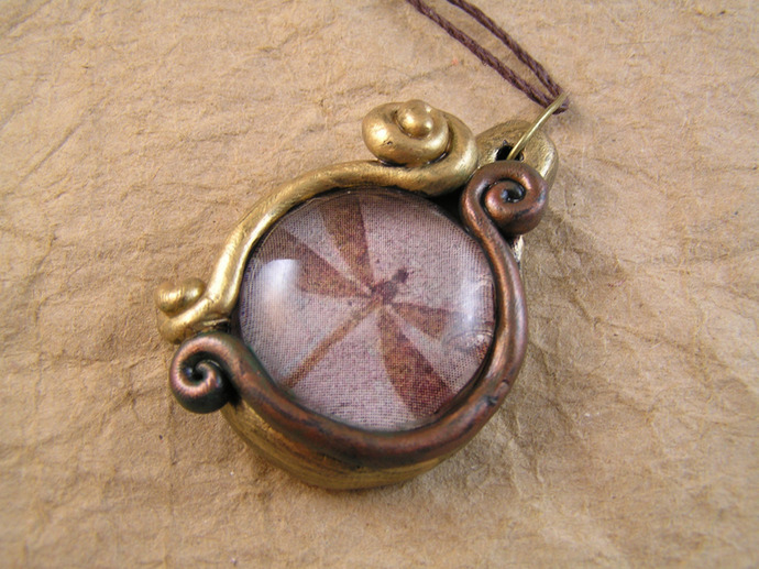 Dragonfly fossil pendant in gold and copper