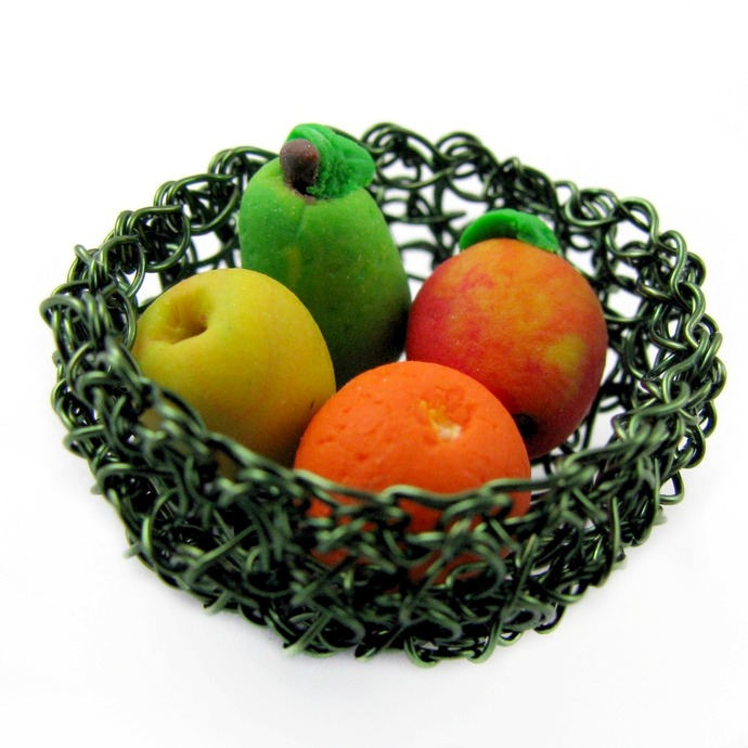 Tiny green wire crochet bowl with polymer clay fruit mix