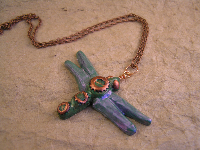 Purple shimmer dragonfly pendant with steampunk clockwork gears detail