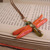 Shimmering Orange dragonfly pendant with steampunk detail