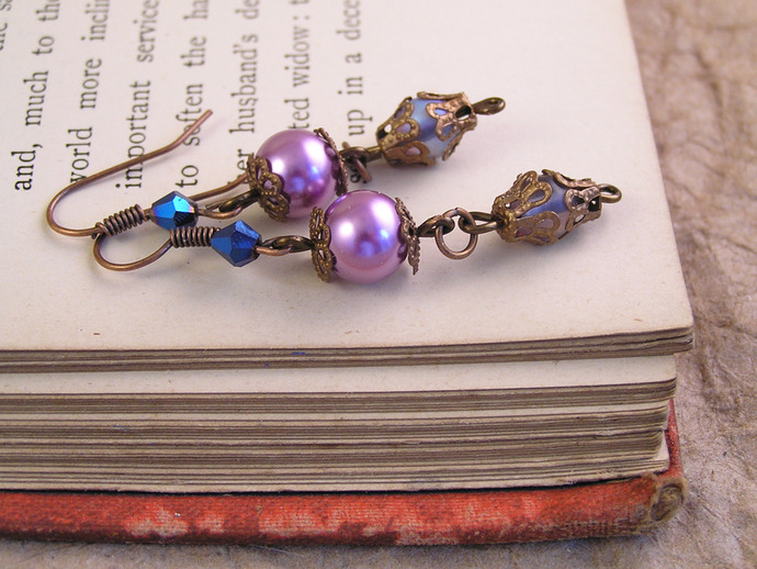 Purple crystal and pearl earrings with copper details