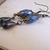 Blue teardrop dangle earrings with antiqued verdigris copper look