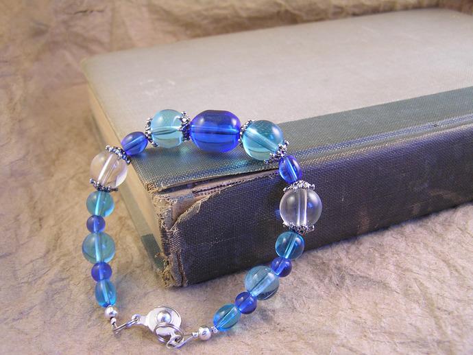 Blue glass bracelet with antiqued silver tone beadcaps
