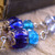 Blue glass dangle earrings with antiqued silver tone beadcaps