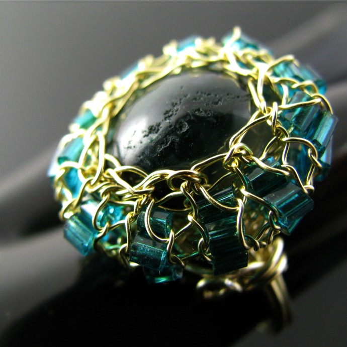 Golden wire knit ring with green moss agate