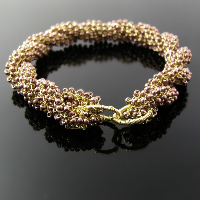Twisted golden wire knit bangle with seed beads