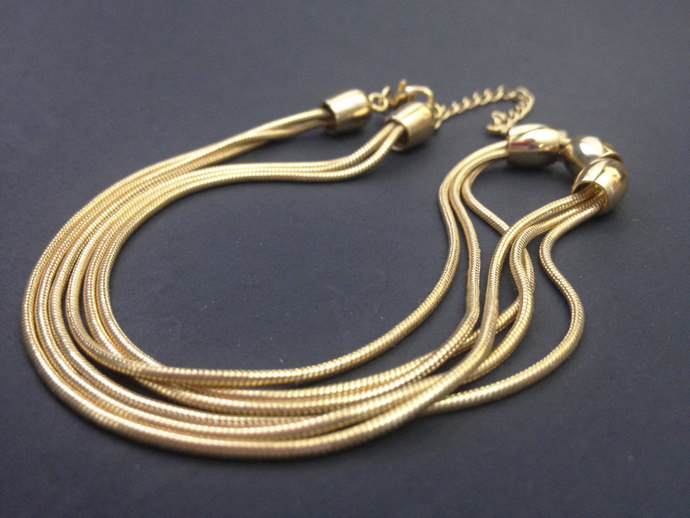 Gold Tone Vintage Napier Necklace with three strands and three gold tone beads!