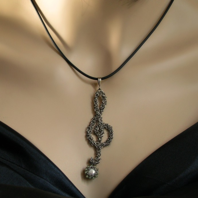 Silver wire crochet musical clef pendant with pearl and peridots