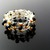 Fine silver wire crochet ring with golden pearls and black spinels