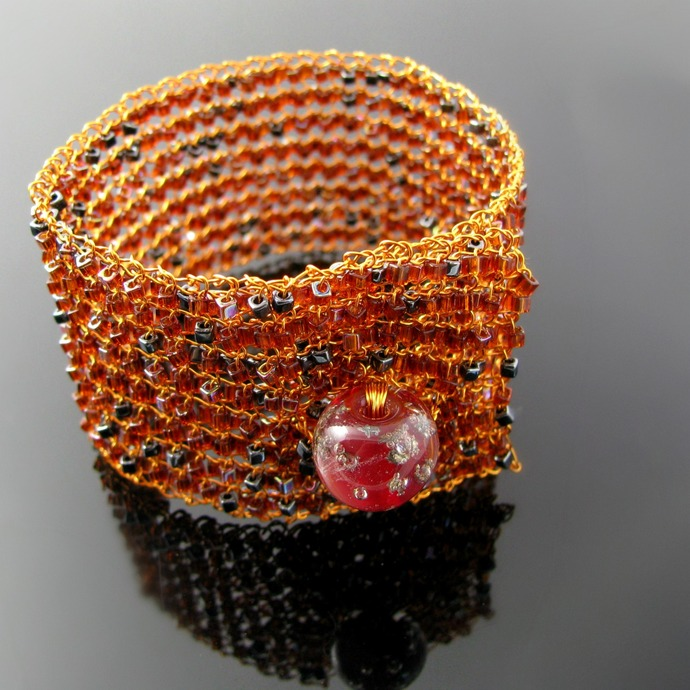 Wire knit bracelet with topaz glass cubes and red lampwork button