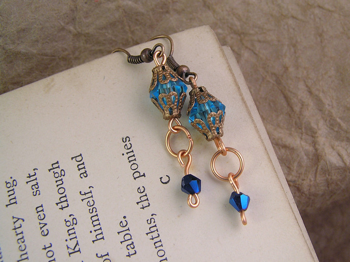 Blue crystal bead earrings with copper filigree beadcaps