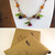 Colorful Blossom necklace with glass flower and leaf beads on copper chain