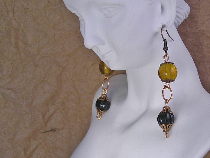 Black and Orange glass earrings with copper filigree beadcaps