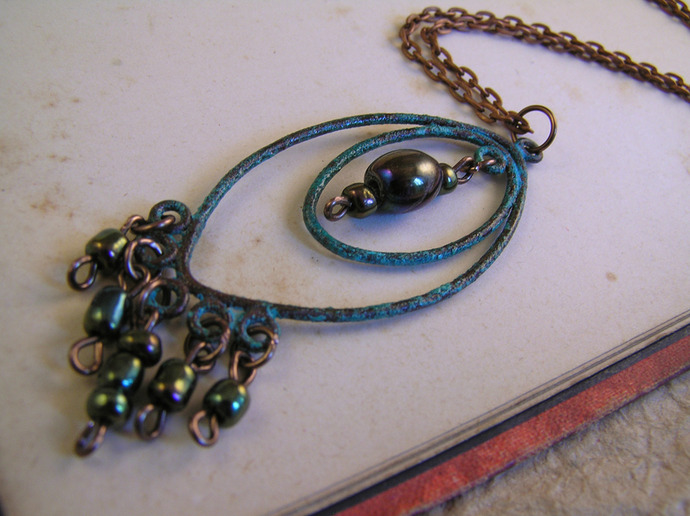 Hand Aged Copper Chandelier necklace with green metallic seed beads