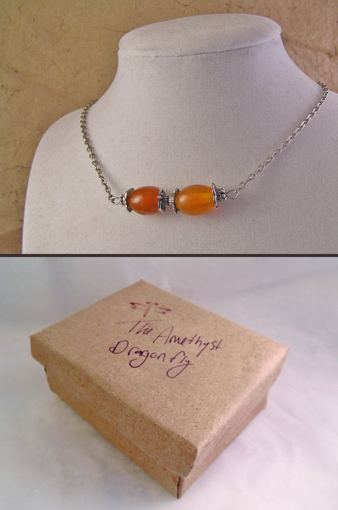 Orange glass bead choker necklace with silvertone details