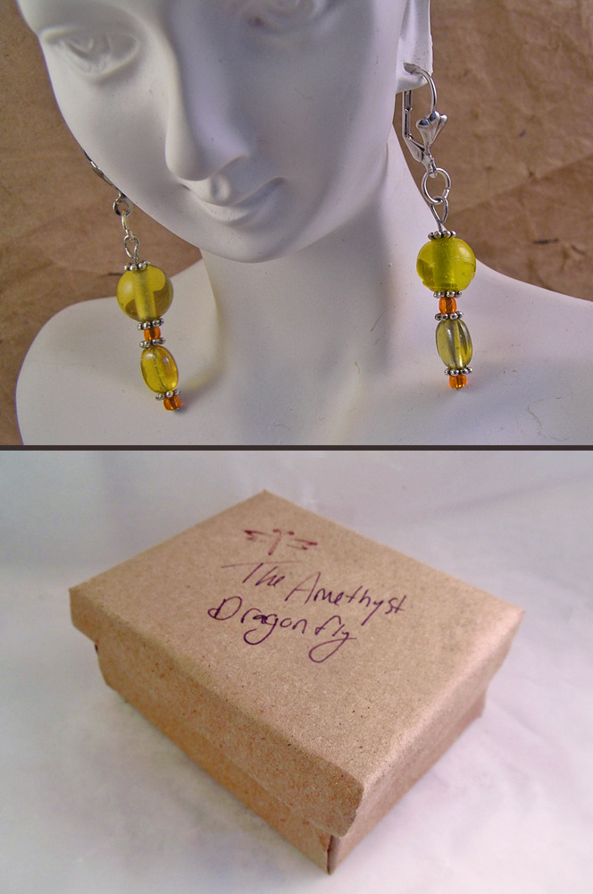 Yellow glass dangle earrings with orange beads and Tibetan silver daisy spacers