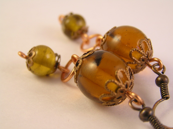 Amber and yellow glass earrings with filigree copper beadcaps