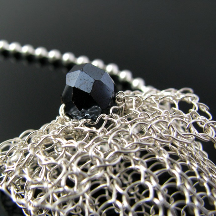 Silver wire knit pouch pendant with dark blue crystal button