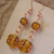 Orange glass flower dangle earrings with copper