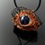 Unique creepy wire crochet eye pendant with lampwork bead