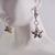 Festive star Dangles Cookie cutter ornament earrings with silver jingle bells