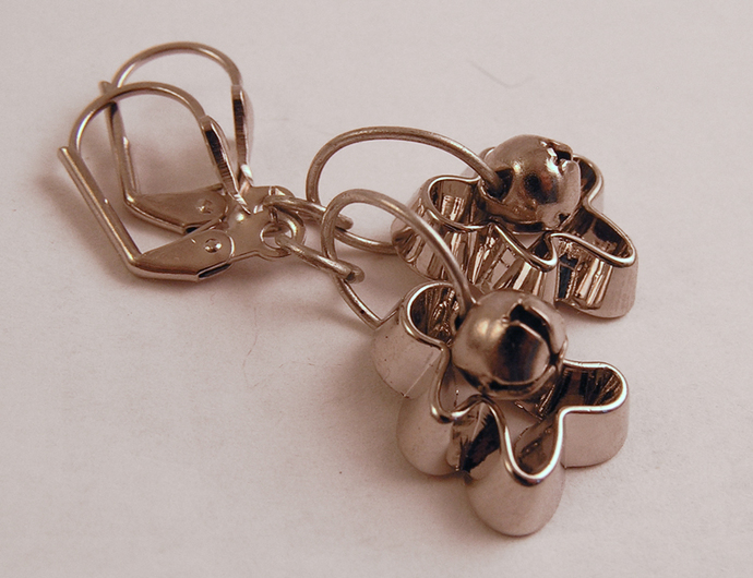Gingerbread men Cookie cutter ornament earrings with silver jingle bells.