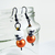 Gothic Skull earrings with orange beads