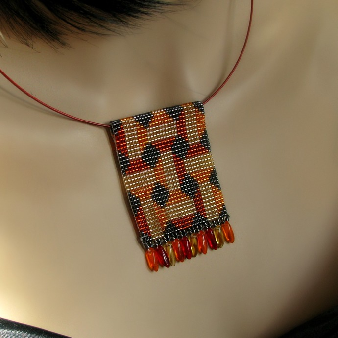 Bead loomed geometric floor tile pendant with silver lined beads