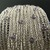 Wide silver tone wire knit cuff with tanzanite crystals