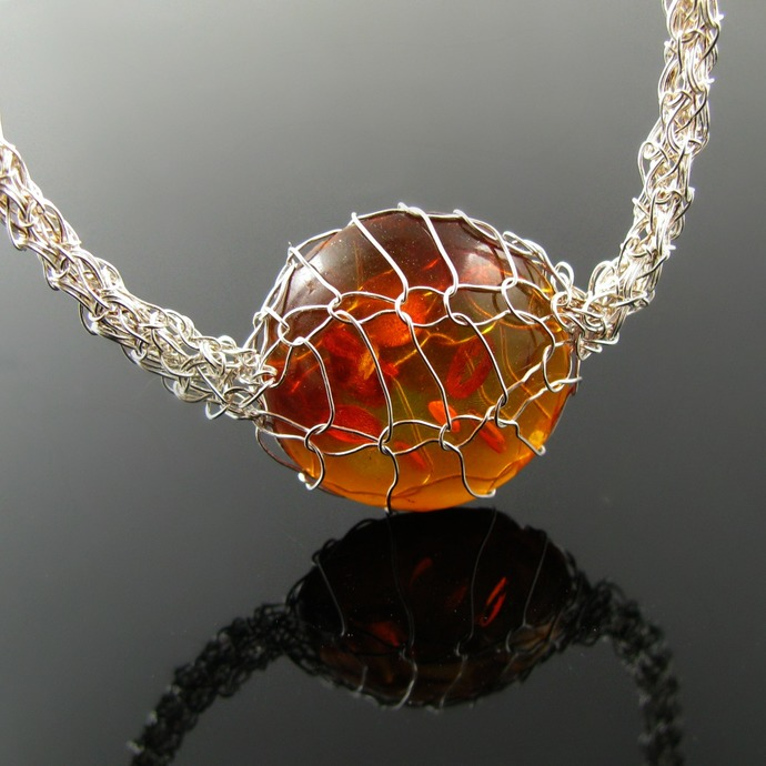 Silver crochet and rope necklace with faux amber cabochon in knit setting