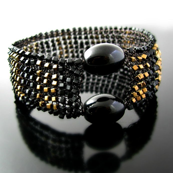 Black wire knit bangle with black and bronze cube beads