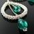 Silver wire crochet drop earrings with dangling green crystal drops