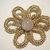 Golden tatted flower brooch
