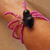 Spooky spider bracelet in brass, pink, and black. Arachnid Halloween jewelry