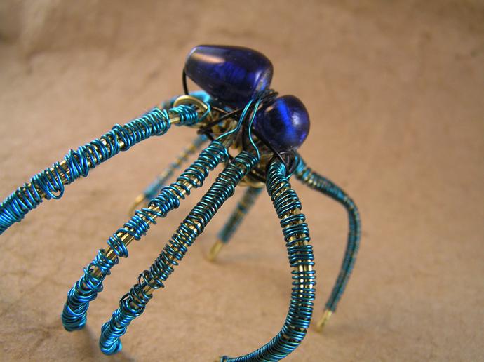 Creepy spider bracelet in blue and brass. Arachnid Halloween jewelry