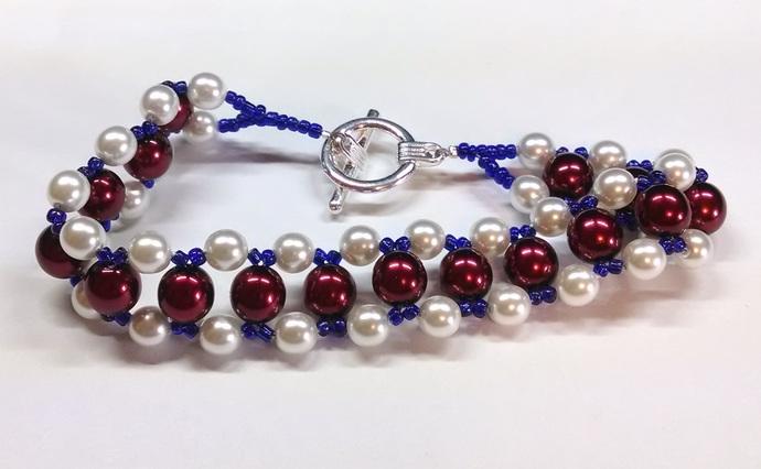 White, red and blue bracelet; 246