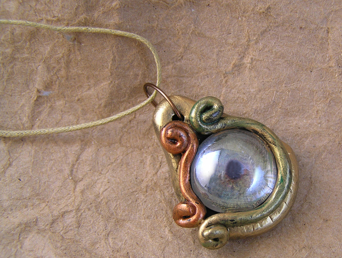 Copper and gold steampunk dragon eye pendant