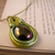 Metallic green steampunk dragon egg pendant